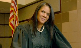 Judge Tanya Brinkley was elected In August of 2012 as a Miami-Dade County Court Judge, after being nominated for gubernatorial appointment. She one of two black women on the Miami-Dade Circuit bench. Judge Brinkley was born and raised in Philadelphia, PA. She attended Howard University in Washington, D.C., where she obtained her Bachelors of Business Administration in Finance in 1991. After attending the CLEO Six-Week Summer Institute at Georgetown University School of Law in 1992, Judge Brinkley attended the University of Miami School of Law, where she also studied at the London College of Law, before earning her J.D. in 1995. Judge Brinkley is assigned to the criminal division at the South Dade Justice Center, where she presides over misdemeanor crimes, domestic violence cases, and uncontested divorces. Judge Brinkley is actively involved in her community. She was recognized by Legacy magazine as one of the 25 Most Influential and Prominent Black Women in Business for 2012. Judge Brinkley was awarded the 2010 Wilkie D. Ferguson, Jr. Bar Association Pro Bono Award, and the 2009 Ray Pearson Guardian Ad Litem Pro Bono Award by the Eleventh Judicial Circuit Family Division Judges for her representation of children in contested family cases.